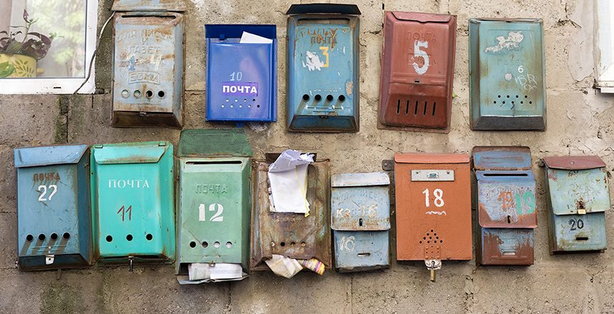 Old mailboxes on a wall.